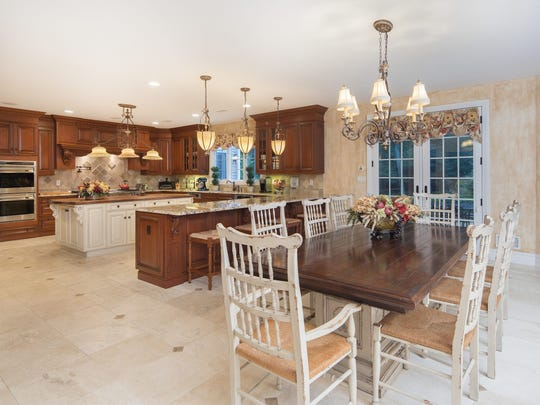 The eat-in kitchen features a huge center island, breakfast bar and space for a kitchenette.