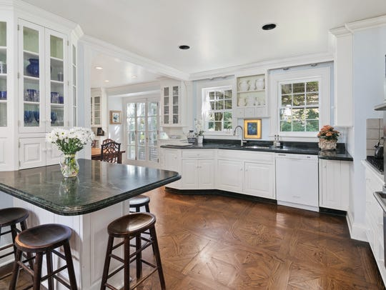 The eat-in kitchen features a breakfast nook and granite