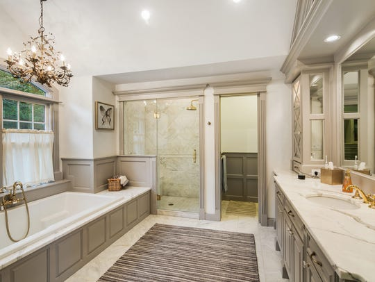 Master bathroom features tub, shower and double sinks.