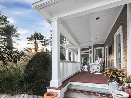 The front porch offers an area for relaxation.