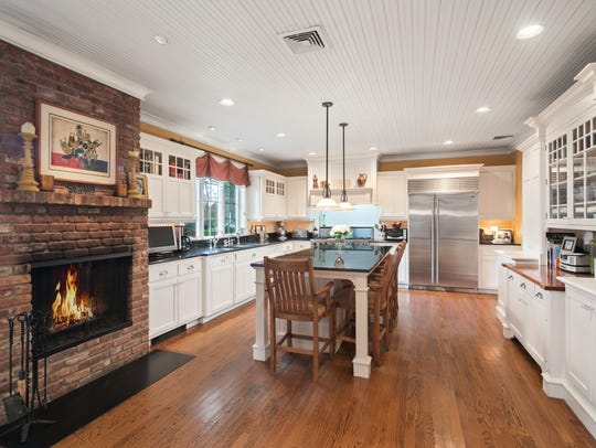 The gourmet kitchen is equipped with stainless steel appliances.