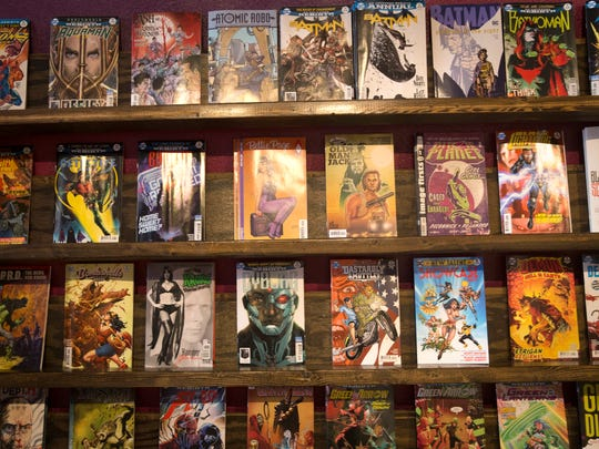 Comic books are displayed Friday at Tales of Tomorrow in Farmington.