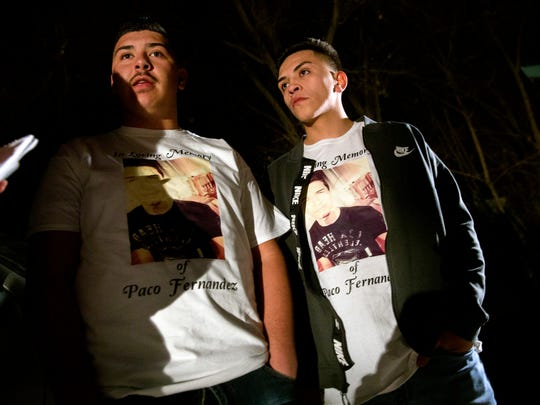 "From left, Ramon Lopez, left, and Elias Aguilar talk about their cousin Francisco ""Paco"" Fernandez during a candlelight vigil on Thursday, Dec. 7, 2017 evening at Minium Park in Aztec."