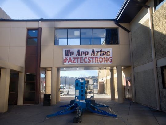 A sign created by Finish Line Graphics hangs at Aztec High School on Monday.