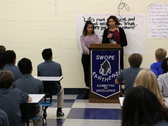 Bullied Yerington teens Jayla Tolliver, left, and Taylissa Marriott thank the students of Swope Middle School for their letters of support on Dec. 12, 2017.