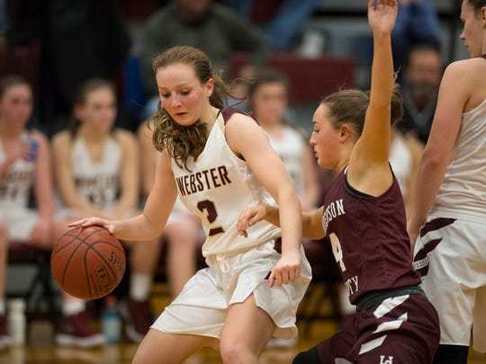 Webster County's Marissa Austin (2) is guarded by Henderson's Savannah Lacer (4) at Webster County High School Tuesday night.