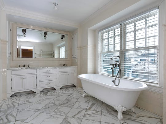 The master bathroom features his and her double sinks