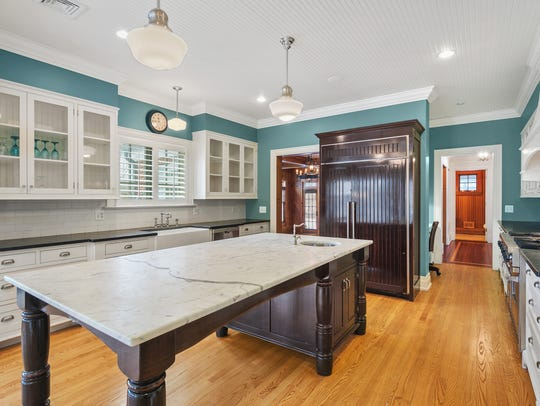 The kitchen offers an expansive center island with