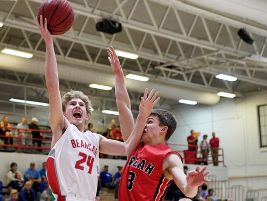Hendersonville's Sawyer Moss shoots a layup as Pisgah's