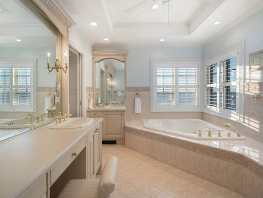 The Master bathroom offers ceramic tile flooring and