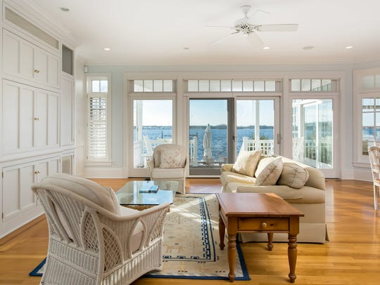 Enjoy the breathtaking views and custom built-ins in the living room.
