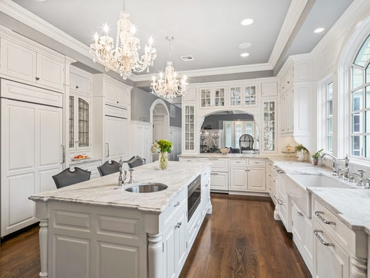 Enjoy the outstanding gourmet kitchen with marble island and counters, with a professional grade Wolf stove.