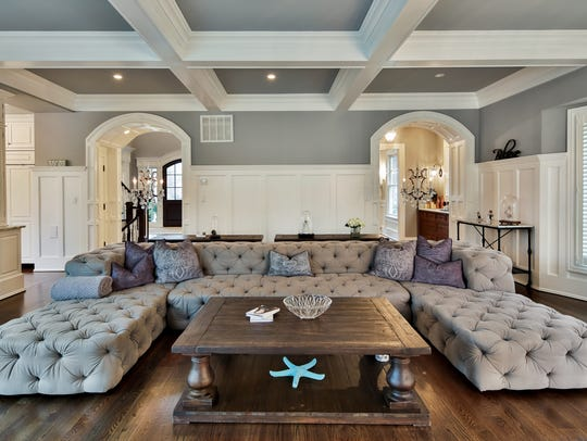 The family room features coffered ceilings and custom