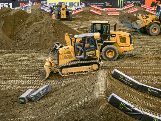 Crews work to construct the Monster Energy AMA Supercross track at  Lucas Oil Stadium on Wednesday, March 21, 2018. Monster Energy AMA Supercross will be racing at the stadium on March 24, 2018.
