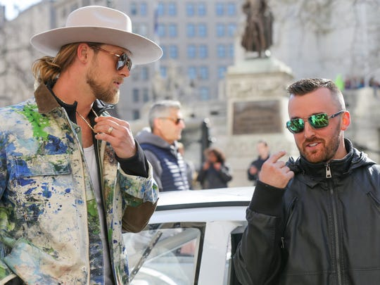 Brian Kelley, from the country duo Florida Georgia Line, left, and 2018 Daytona 500 winner Austin Dillon, right, arrive for a major Brickyard 400 announcement at the Columbia Club in Indianapolis on Thursday, March 22, 2018.
