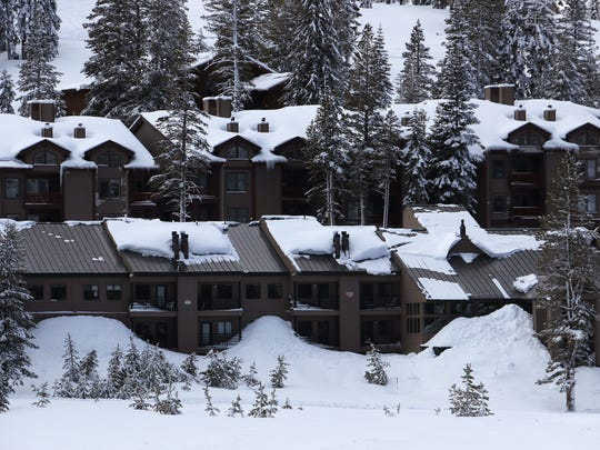 Snow laden rooftops are seen on lodging at Kirkwood Mountain Resort in California on March 23, 2018.