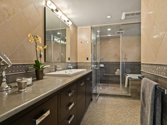 The master bath has a modern design that includes his
