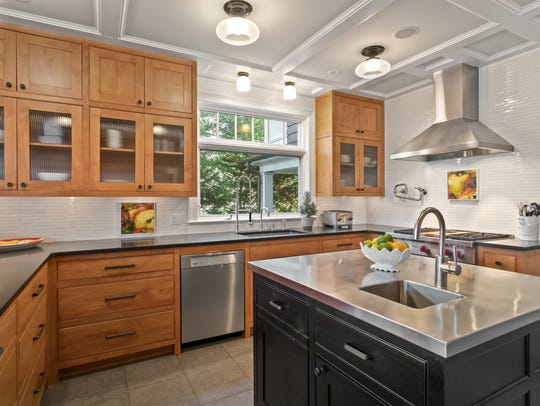 Design with coffered ceilings and custom cabinetry