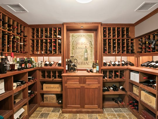 An expansive customized wine cellar with tile flooring.