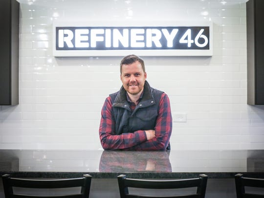 Co-founder of Refinery 46, Brian Schutt stands in the lower level coworking space geared toward contractors, home services and construction companies in Indianapolis on Tuesday, April 3, 2018. The building, located at 2201 E. 46th St. was formerly the home of Double 8 Foods Inc.