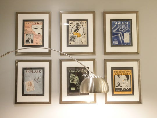 Vintage playbills for Indiana artists hang in The Cabaret,