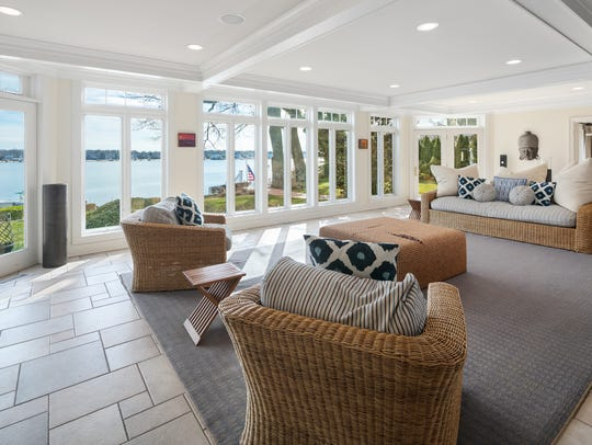 The great room features amazing custom windows and a set of french doors that enhance the views of the river.