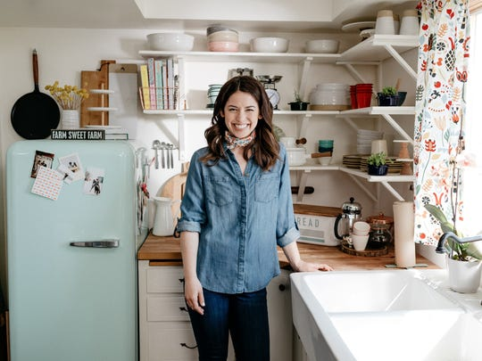 "Molly Yeh in her kitchen on ""Girl Meets Farm."""
