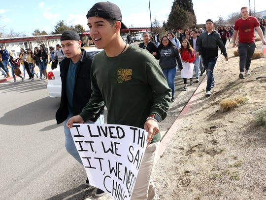 Student Body President Alex Trujillo, front, leads his classmates at Wooster High School in Reno during a nationwide walkout to protest gun violence on March 14, 2018.