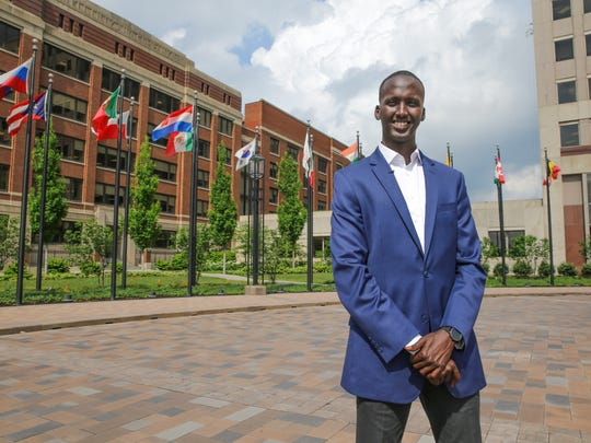 Eli Lilly and Company Investor Relations Analyst, and former Somali refugee, Mohamed Osman Mohamed brings awareness to World Refugee Day, Wednesday, June 13, 2018. Here Mohamed stands in front of the Eli Lilly and Company headquarters in Indianapolis Indiana.