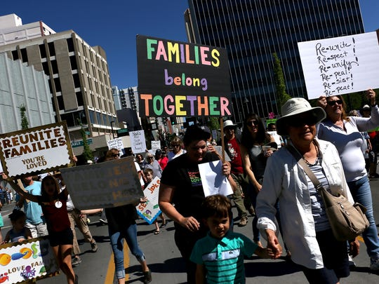 Over 1000 people take part in the Families Belong Together rally and march in downtown Reno on June 30, 2018.