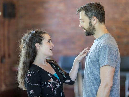 Lauren Worsham and Ken Barnett are shown in rehearsal