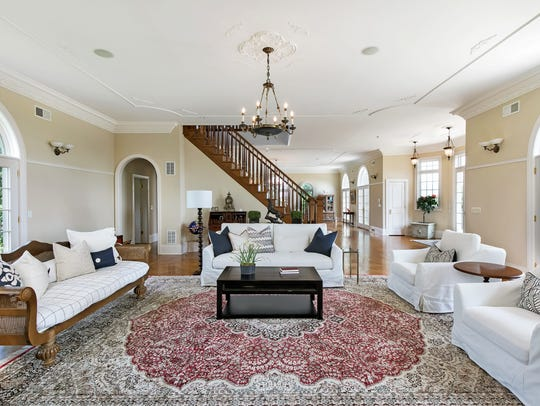 The living room offers French Door and decorative crown molding on the ceiling.