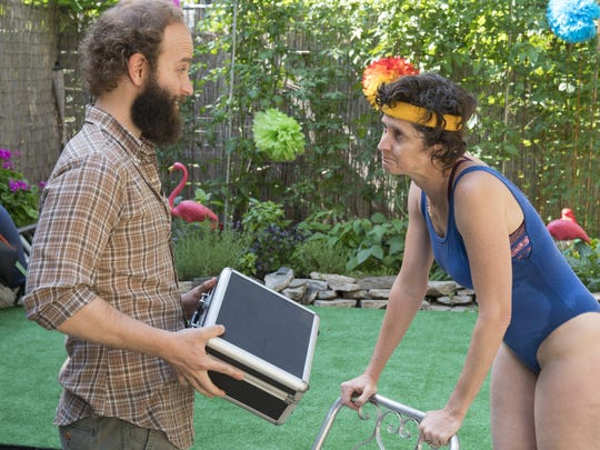 The Guy (Ben Sinclair, left) delivers some much-needed bud to competitive dancer Gloria (Alex Auder) in a scene from HBO's 'High Maintenance.'