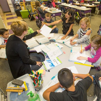 Third-graders work in Amber Moore's classroom at Four