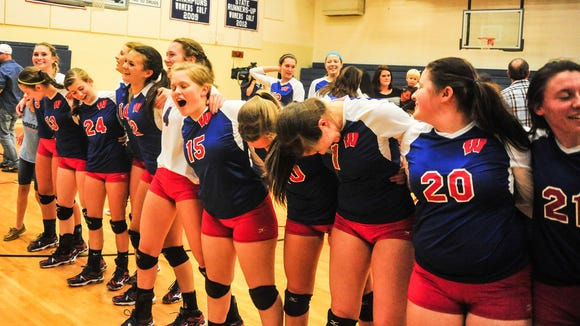 Rachel Kordonowy (4) and the West Henderson volleyball team won the 3-A Western Regional championship in 2014.