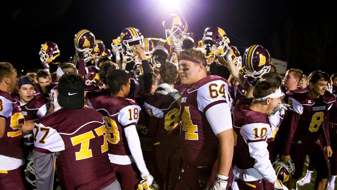 The Windsor football team celebrates its 44-0 victory over Fort Collins Friday.