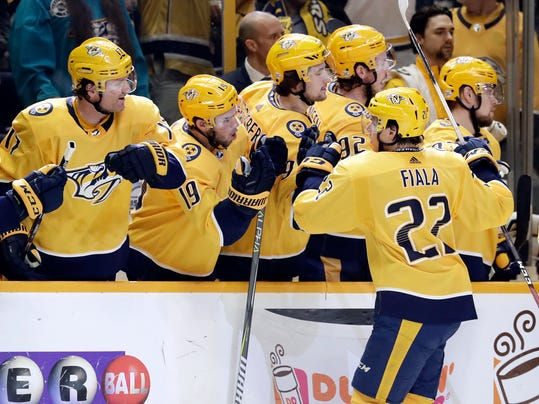 Nashville Predators left wing Kevin Fiala (22), of Switzerland, is congratulated after scoring against the St. Louis Blues in the first period of an NHL hockey game Sunday, Feb. 25, 2018, in Nashville, Tenn. (AP Photo/Mark Humphrey)