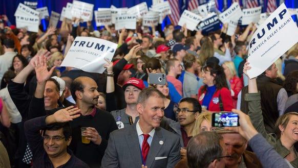 Donald Trump supporters celebrate his primary win in