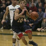 Mend ham #22 Jamie Conklin looks for a pass. Mendham takes on Delbarton in boys hoops in front of a capacity crowd at Delbarton. Morristown, NJ. Friday, Dec. 18, 2015. Special to NJ Press Media/Karen Mancinelli/Daily Record MOR 1219 BB Mendham-Delbarton