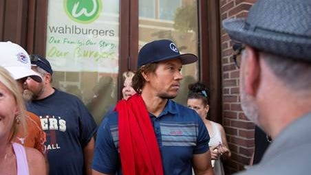 Mark Wahlberg chats with onlookers Saturday in Greektown in Detroit.