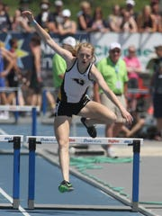Southeast Polk freshman Grace Larkins runs to a fifth-place finish overall in the Class 4A 400-meter hurdles in the 2018 state track meet held at Drake Stadium. The team finished third overall.