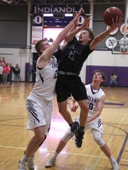 Norwalk sophomore Bowen Born tries to get a shot away between Indianola seniors Cole Scott and Brady Held. Indianola upset Class 3A fourth-ranked Norwalk 66-62 at home on Jan. 23.