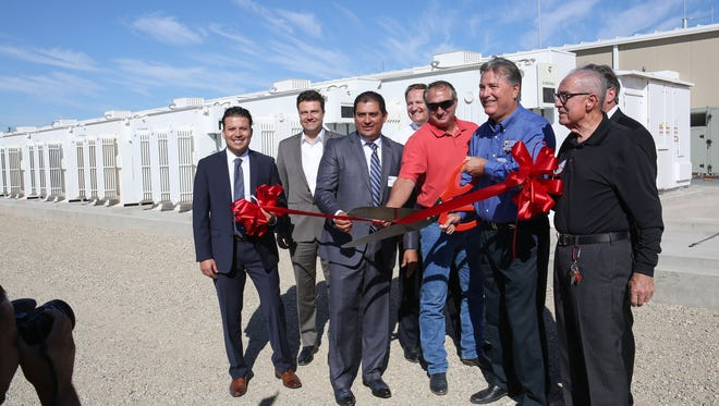 Imperial Irrigation District officials and project partners cut a ribbon to inaugurate the utility's battery facility in El Centro on Oct. 26, 2016.
