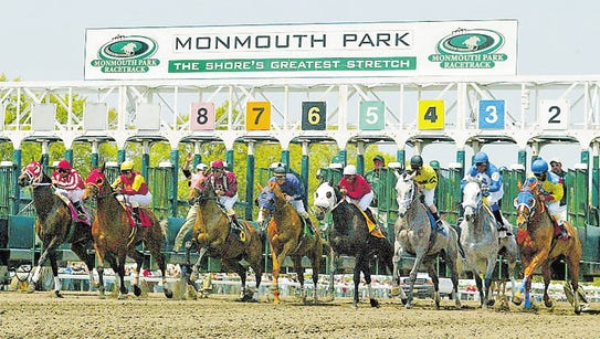 The horses are out of the gate in this 2005 photo at