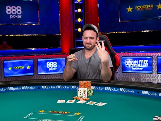 Joe Cada celebrates his third World Series of Poker