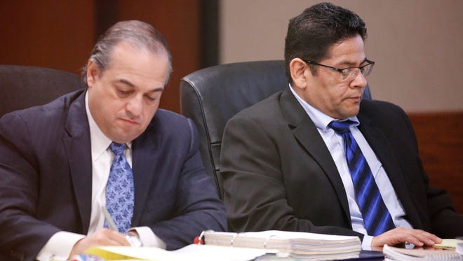 Raymundo Carranza, right, and his attorney, Ray Gutierrez, take notes Tuesday as a witness testifies during the first day of his trial in the 409th District Court. Carranza, 48, a former El Paso County sheriff's deputy arrested in connection with a fatal 2012 car accident, is charged with manslaughter, intoxicated manslaughter and accident involving injury or death, according to court records. Carranza is accused of striking and killing Richard Lopez, 26, on May 12, 2012, on Spur 601. Lopez had stopped on the highway at about 4 a.m. to fix a flat.