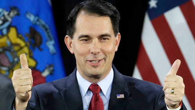Gov. Scott Walker gives a thumbs up after being re-elected in November 2014.