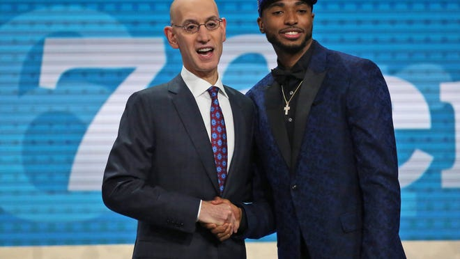 Villanova's Mikal Bridges, right, poses with NBA Commissioner Adam Silver after he was picked 10th overall by the Philadelphia 76ers during the NBA basketball draft in New York, Thursday, June 21, 2018. (AP Photo/Kevin Hagen)