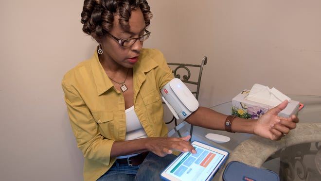 Instead of traveling to a doctor's office, Jackson resident Thomasene Bennett uses telehealth to take and transmit her blood sugar and vital signs via Bluetooth and iPad Mini technology.