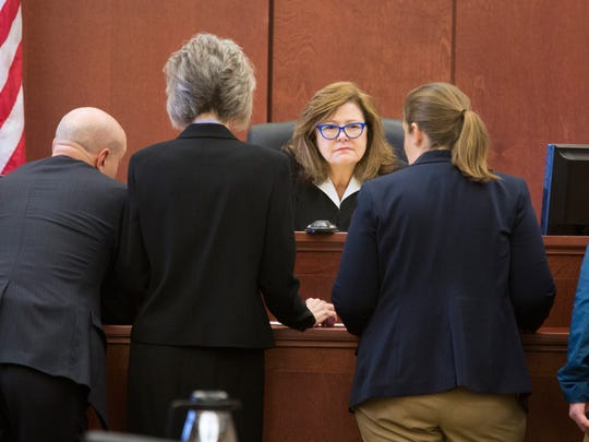 Kenton Circuit Judge Kathleen Lape talks to attorneys during what was supposed to be the sentencing of Tim Nolan, former judge and conservative activist. At the start of the proceedings, Nolan fired his attorneys. Eva Hager, center right, and Aaron Currin, public defenders, were appointed for Nolan. At left are Jeff Prather and Barbara Whaley, both assistant attorney generals. Nolan was to be sent to prison for human trafficking on Thursday. Instead, Nolan tried to withdraw his guilty plea and now wants to be co-counsel.